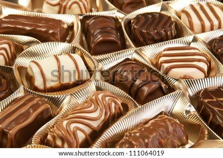 Box of chocolates with many variations - stock photo