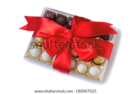 Box of delicious chocolates, nicely decorated and tied with a ribbon gift for any holiday or celebration. Presented on a white background - stock photo