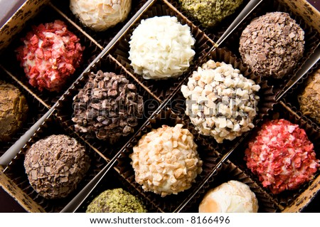 Box of different luxury handmade chocolates - stock photo