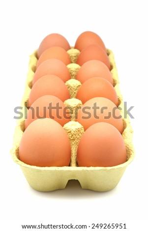 Box of eggs on white background - stock photo