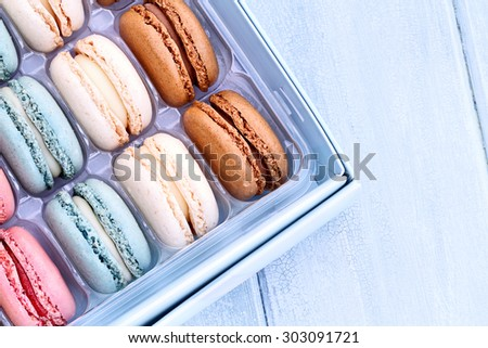 Box of fresh colorful macarons with room for copy space.  - stock photo