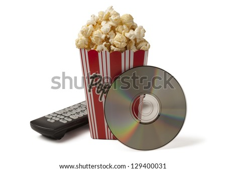 Box of fresh popcorn with TV remote control and movie CD on white background. Clipping path included. Concept of entertainment, movie / show time. - stock photo