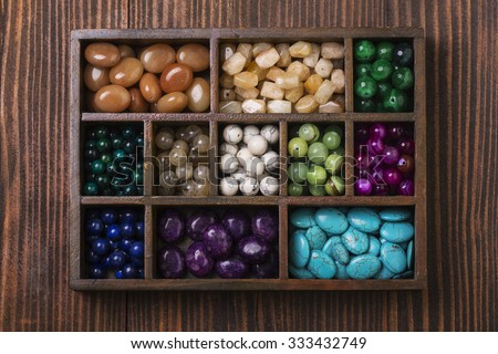 Box of gemstones upper view - stock photo