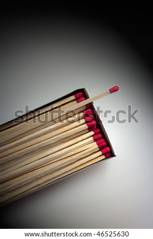 Box of Matches lit by Spotlight on neutral background - stock photo