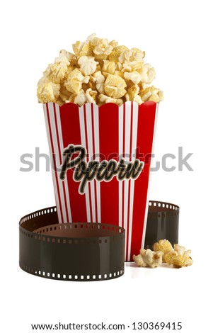 Box of popcorn and film isolated on white background. Clipping path included. Concept of Movie time or entertainment. - stock photo