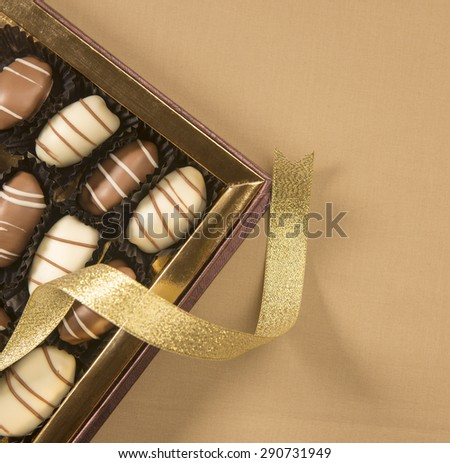 Box of premium date-chocolates. view from above. - stock photo