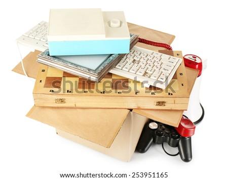 Box of unwanted stuff isolated on white - stock photo