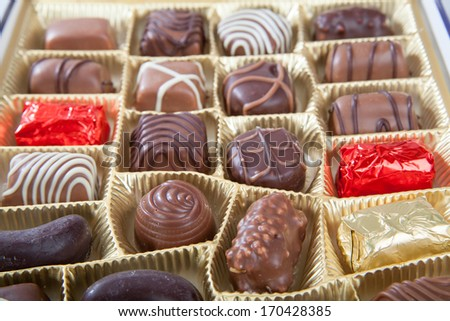 box of various chocolate candies - stock photo