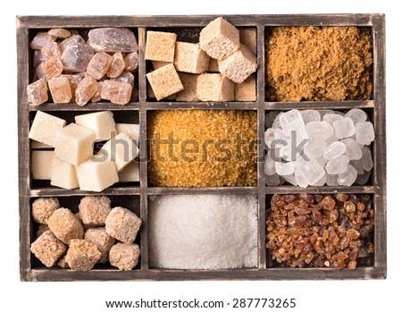 Box of various kinds of sugar closeup top view - stock photo