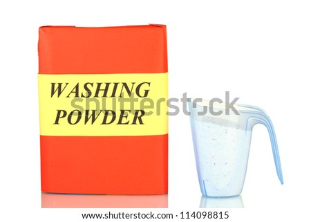 Box of washing powder with blue measuring cup isolated on white - stock photo