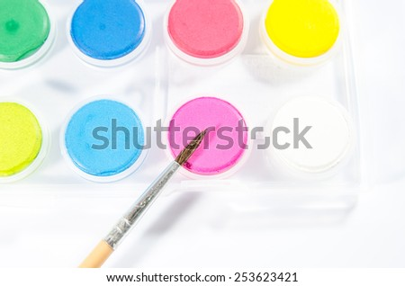 box of watercolor and paintbrush - stock photo