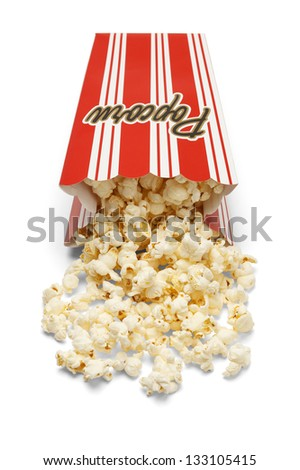 Box of yellow butter popcorn spilled on the ground isolated on a white background. - stock photo