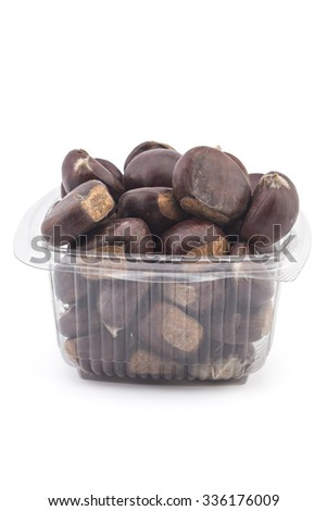 Box or punnet of fresh organic chestnuts isolated on white background - stock photo