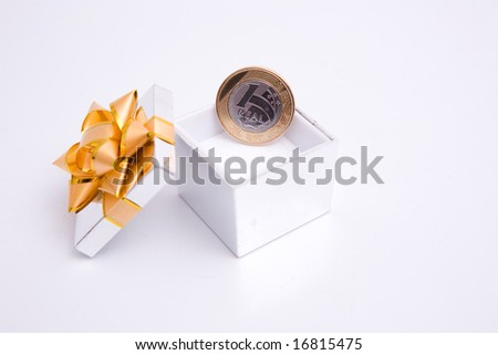 box to gift and coin on the white background - stock photo