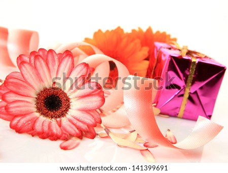 Box with a gift and flower