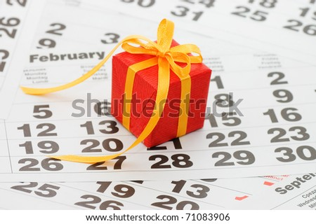 Box with a gift on calendar sheet - - Valentines day - stock photo