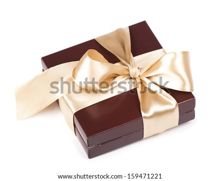 Box with candies and golden tape  isolated on the white - stock photo