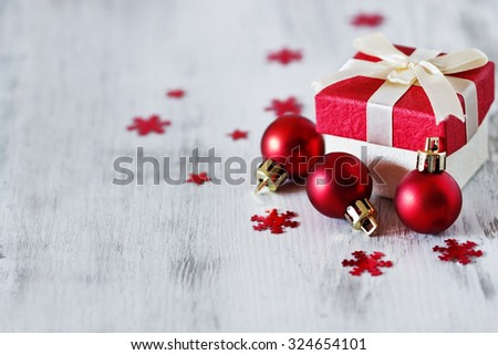 box with christmas gifts and christmas decorations on a white wooden background. selective focus. copy space for you text - stock photo