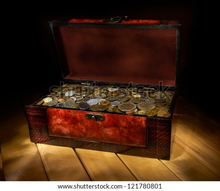 Box with coins - stock photo
