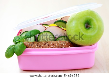 box with delicious sandwich and some fruits - food and drink - stock photo