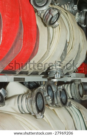 Box with fire hoses. - stock photo