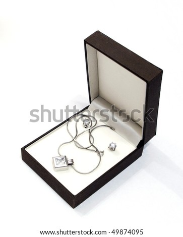 box with jewelry against the white background - stock photo