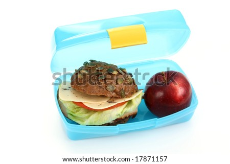 box with lunch - delicious sandwich and fruit on white - stock photo