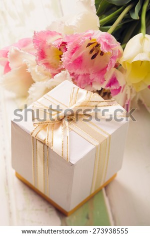 Box with present and tulips for mom - stock photo
