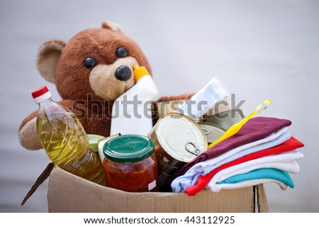 Box with stuffs for donation - stock photo