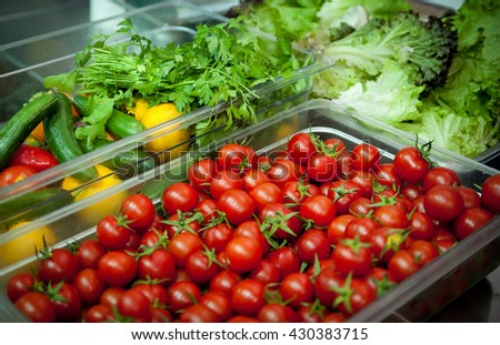 Box with tomatoes and other vegetables