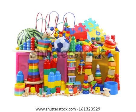 Box with very many toys - stock photo