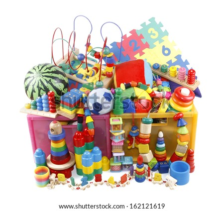 Box with very many toys - stock photo