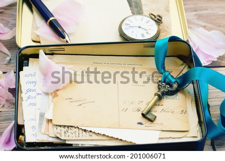 box with vintage mail and antique clock - stock photo