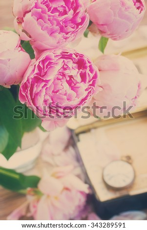 box with vintage mail and antique clock with peony flowers, retro toned - stock photo
