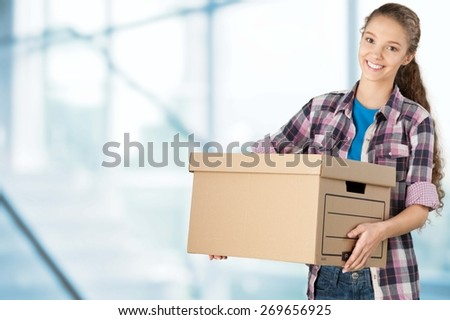 Box. Young woman holding box - stock photo