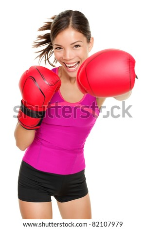 Boxer - fitness woman boxing wearing boxing gloves. Fitness boxing instructor punching fun and fresh towards camera. Beautiful mixed race Asian / Caucasian fitness girl isolated on white background. - stock photo
