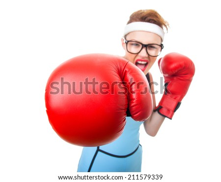 Boxer - fitness woman boxing wearing boxing gloves, focus on gloves - stock photo