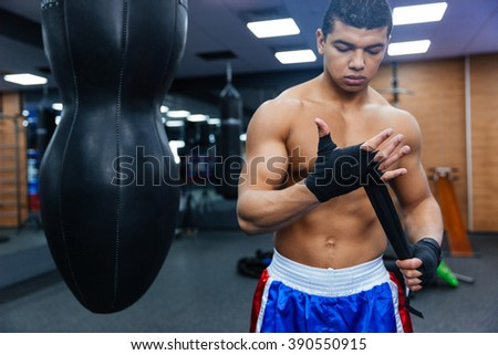 Boxer getting ready for fight in gym - stock photo