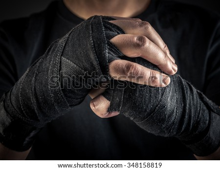 boxer hands in wrist wraps - stock photo