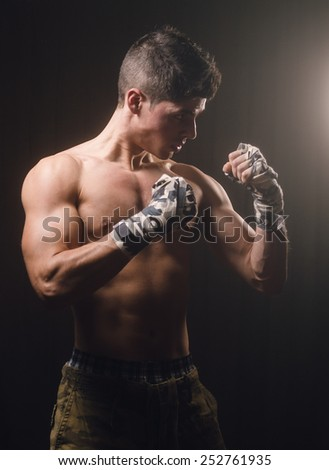 Boxer man on guard in a studio shot - stock photo