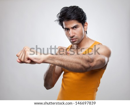 Boxer showing off a hard punch - stock photo