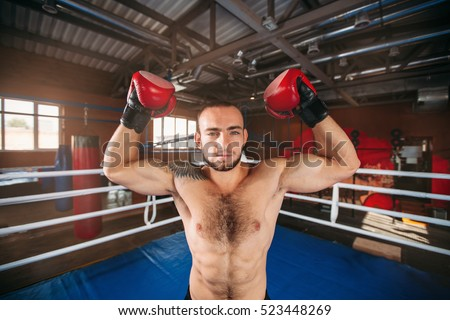 Boxer shows muscles.