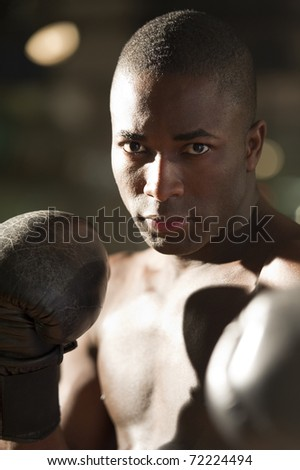 Boxer Throwing Punch - stock photo