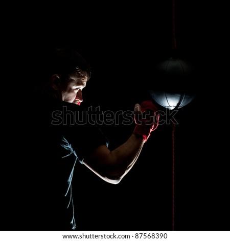 boxer training on black background - stock photo