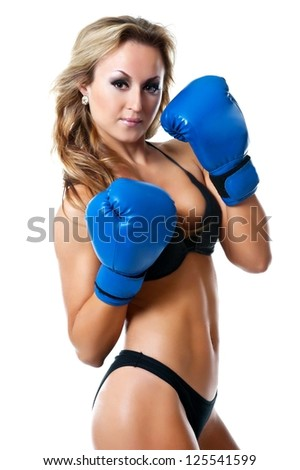 Boxer woman. Boxing fitness woman  wearing blue boxing gloves. Portrait of sporty fit Asian Caucasian model on white background.