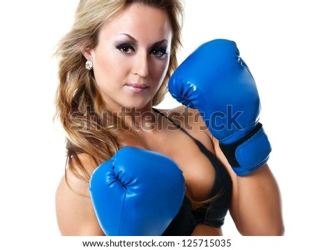 Boxer woman. Boxing fitness woman wearing blue boxing gloves. Portrait of sporty fit Asian Caucasian model on white background. - stock photo