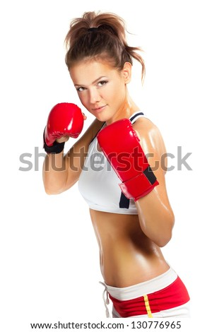 boxer woman during boxing exercise in defence position with red - stock photo