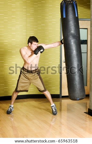 Boxer working out on punching bag