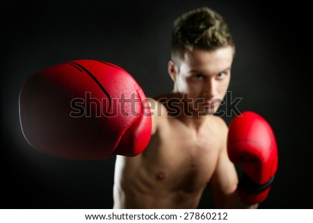 Boxer, young age handsome man over black background