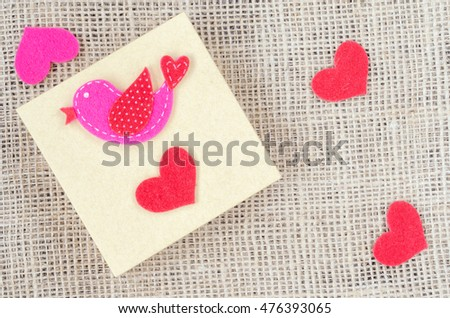 Boxes for gifts and paper heart on the sackcloth